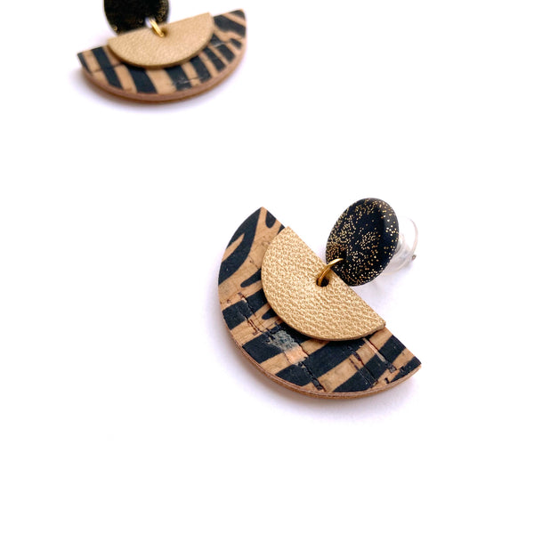 Half circle leather earrings by Two boss beads