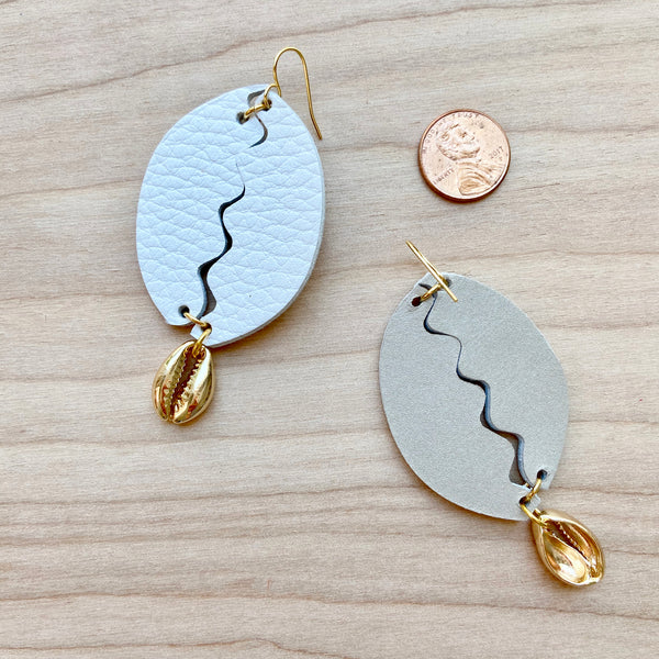Cowrie shell earrings by Two boss beads