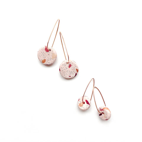 Gold hoop earrings with pink terrazzo bead