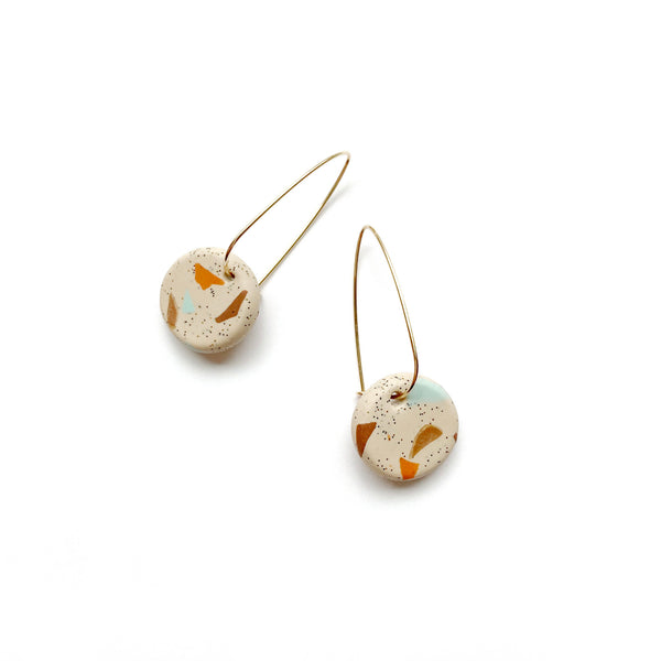 Gold hoop earrings with beige terrazzo bead