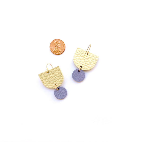 Geometric earrings in yellow by Two boss beads