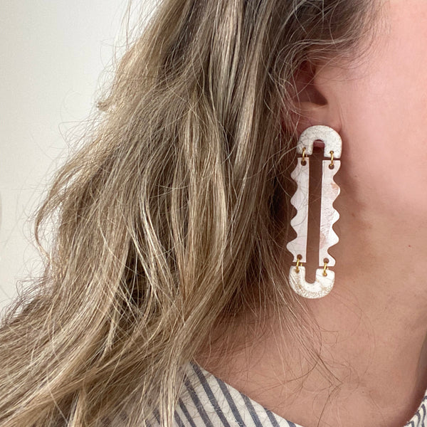 White squiggle earrings by Two boss beads