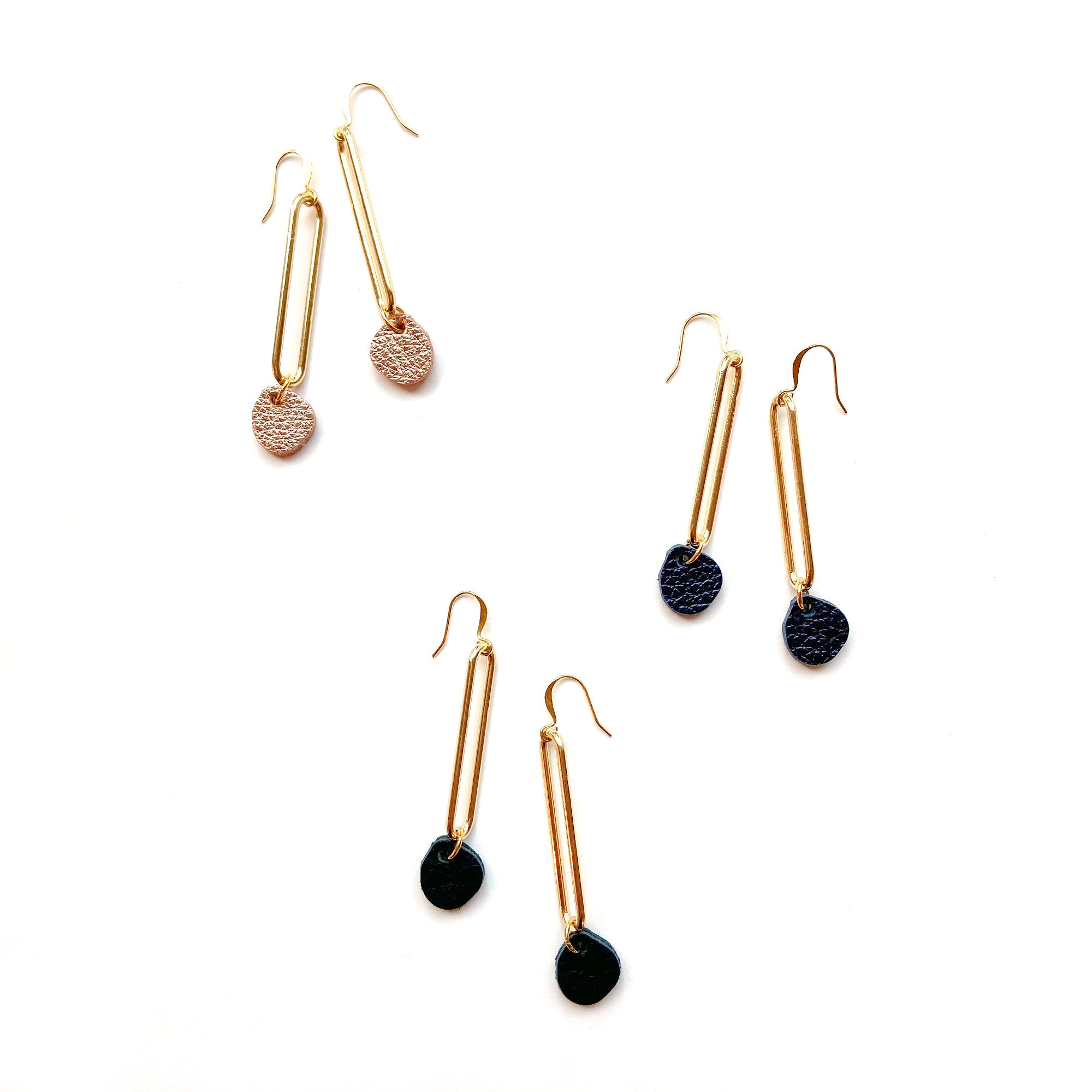 Sample Long gold earrings with leather drop
