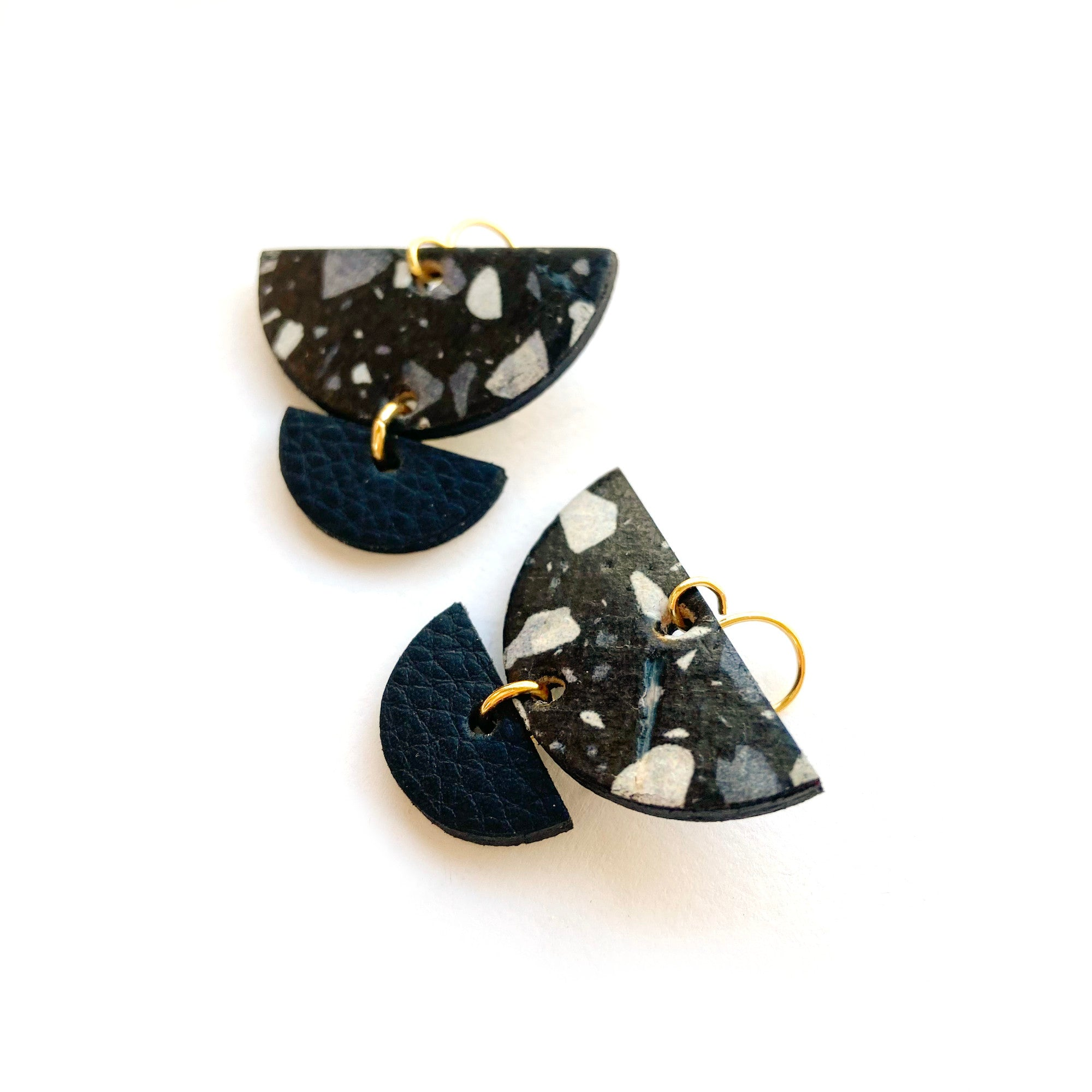 Small half circle geometric earrings by Two boss beads