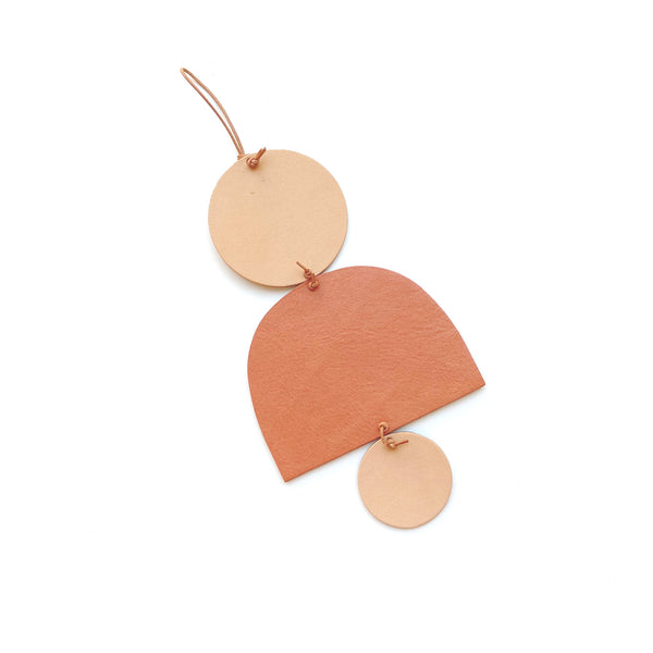 Small leather wall hanging by Two boss beads