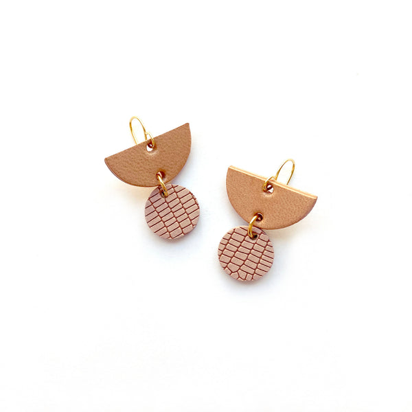 Small geometric earrings by Two boss beads