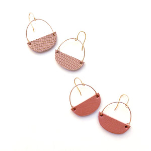 Leather hoop earrings by Two boss beads