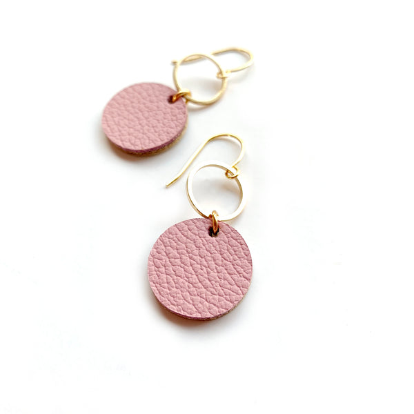 Small circle dangle earrings in pink leather by Two boss beads