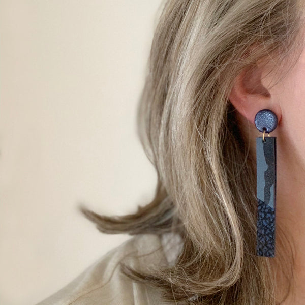 Long dangle earrings in blue camo print leather by Two boss beads