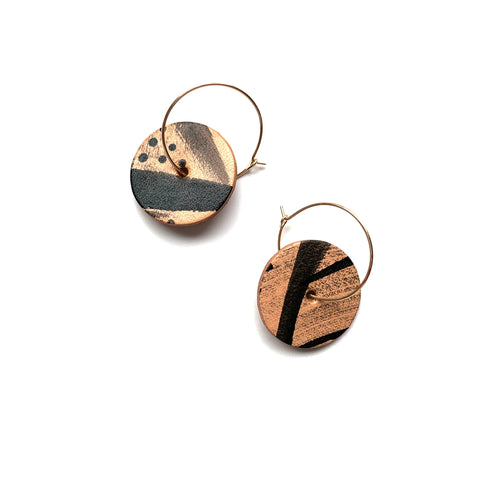 Leather statement earrings by Two boss beads