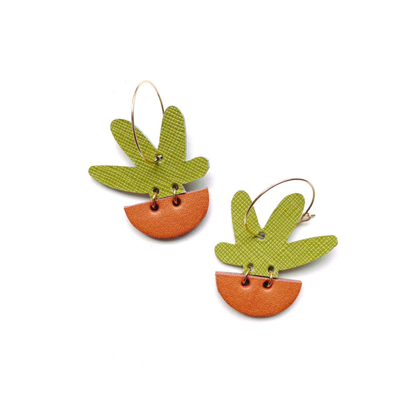 Gold hoop earrings with potted plant