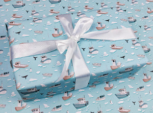 winter boats and ocean animals holiday gift wrap