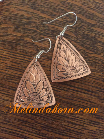 Copper engraved triangles