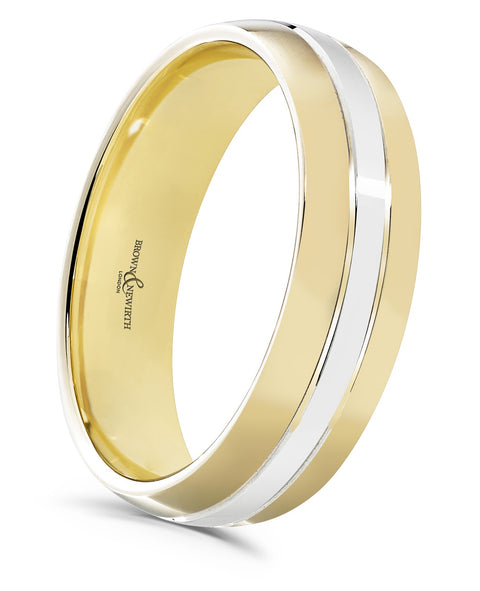 The perfect pairing of two colours, this court shaped ring is handcrafted in gold