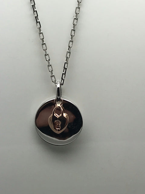 Silver heart disc with rose gold lock.