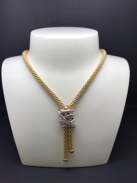 Yellow gold on silver chain.