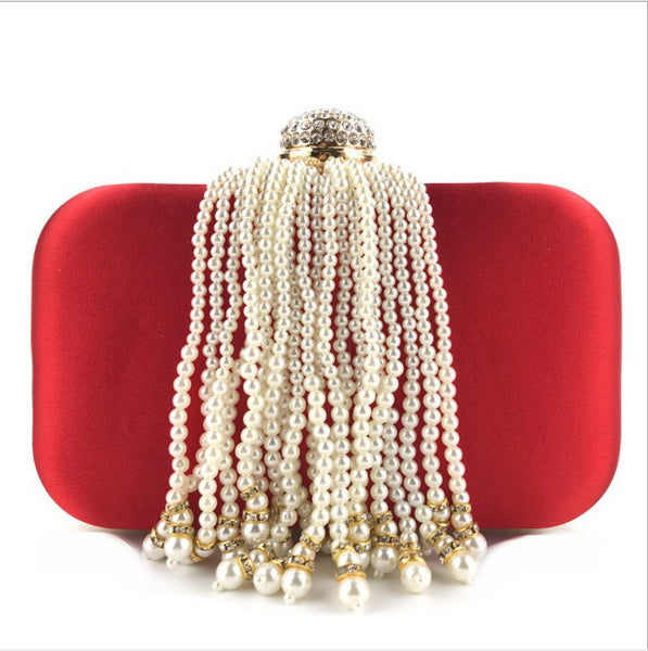 red cluthc bag with pearls wrapped down satin material curvaceous fashion curves