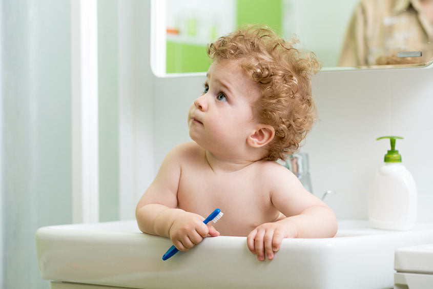 child with a toothbrush