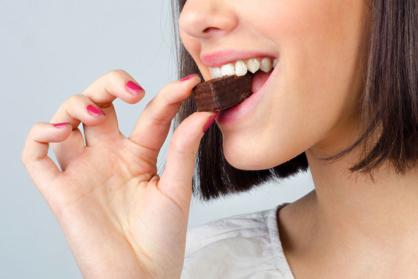 girl eating chocolate cookies