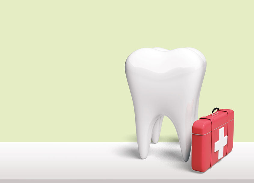 tooth with red first aid kit
