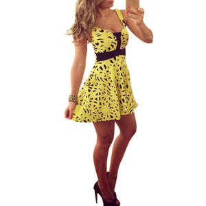 Beautiful yellow women's dress in a sexy sleeveless casual printed design