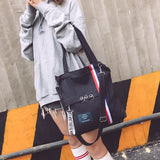 Korean version of canvas bag female shoulder soft face handbag small fresh simple ladies bag Wenyi Sen female shopping bag