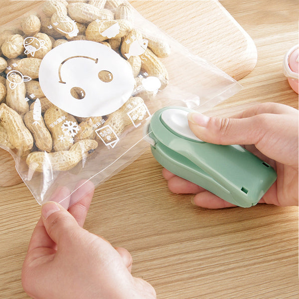 【Buy ONE get ONE FREE】Portable Bag Clips Handheld Mini Sealing Machine Plastic Bag Clip