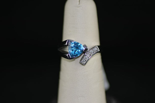 2CT Blue Topaz Ring with .10CT Diamonds