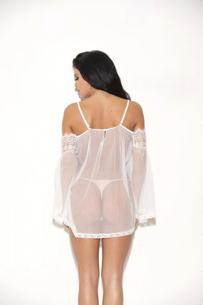 back view of model wearing see through lace tunic