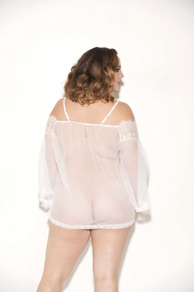 back view of plus size model wearing see through lace tunic dress