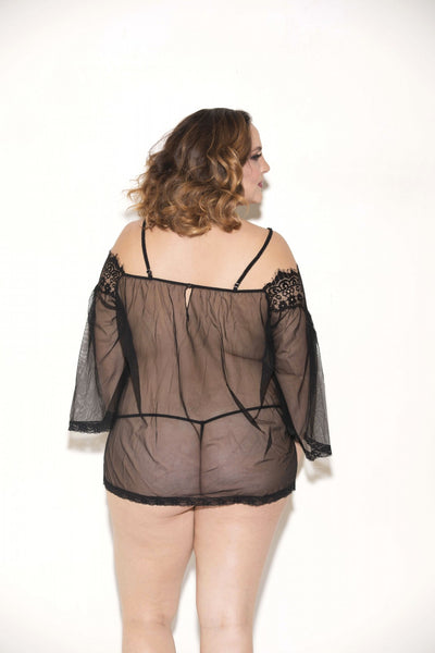 back view of plus size model wearing see through black lace tunic dress