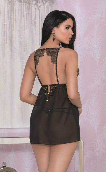 Back view of woman wearing strappy thong and modelling see through black and gold lace trim dress
