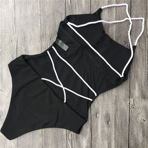 This beautiful and trendy black swimsuit is padded and has an open back, the white bands in the back give it a nice touch as they cross from side to side and helps the swimsuit highlight your bodylines. The material is solid and made of 82% nylon and 18% spandex.