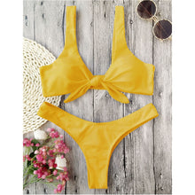 This yellow bikini set has a low waist bottom and the top part has shoulder bands and is knotted in the front. The top part also gives a nice push-up and it's completely wire free. The set is made of 82% polyester and 18% spandex, which gives the bikini flexibility and makes it shape beautifully around your body.