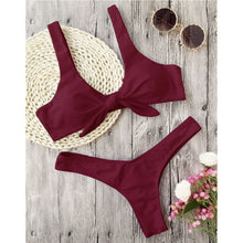 This burgundy bikini set has a low waist bottom and the top part has shoulder bands and is knotted in the front. The top part also gives a nice push-up and it's completely wire free. The set is made of 82% polyester and 18% spandex, which gives the bikini flexibility and makes it shape beautifully around your body.