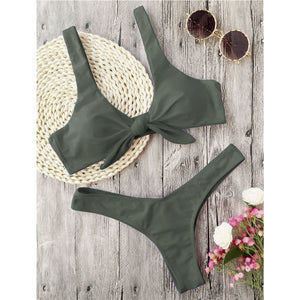This army green bikini set has a low waist bottom and the top part has shoulder bands and is knotted in the front. The top part also gives a nice push-up and it's completely wire free. The set is made of 82% polyester and 18% spandex, which gives the bikini flexibility and makes it shape beautifully around your body.