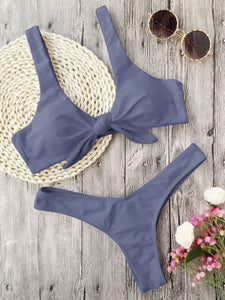 This grey bikini set has a low waist bottom and the top part has shoulder bands and is knotted in the front. The top part also gives a nice push-up and it's completely wire free. The set is made of 82% polyester and 18% spandex, which gives the bikini flexibility and makes it shape beautifully around your body.
