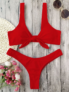 This red bikini set has a low waist bottom and the top part has shoulder bands and is knotted in the front. The top part also gives a nice push-up and it's completely wire free. The set is made of 82% polyester and 18% spandex, which gives the bikini flexibility and makes it shape beautifully around your body.