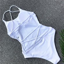 This beautiful and trendy white swimsuit is padded and has an open back, the white bands in the back give it a nice touch as they cross from side to side and helps the swimsuit highlight your bodylines. The material is solid and made of 82% nylon and 18% spandex.