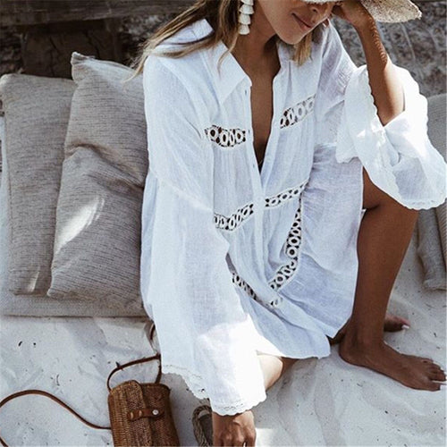 This white beach dress looks beautiful on top of any swimsuit or bikini; it's light and dries fast. Its length mini, it has buttons from top to bottom and it has three beautiful embroidered pattern stripes across the chest, waist and legs. Perfect to just put on, as it has a beautiful oversized look.