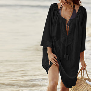 This is a traditional yet trendy black cover-up tunica, it's perfect to put over your swimwear and it provides a high level of comfort and will make you look great.  Its arm length is three quarters long and the collar section is wide and shaped like a V, the width can be adjusted with a long lace with frilling at each end. The collar and is decorated with a beautiful floral embroidered pattern. This beautiful tunica is made out of cotton.