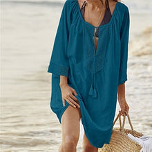 This is a traditional yet trendy blue cover-up tunica, it's perfect to put over your swimwear and it provides a high level of comfort and will make you look great.  Its arm length is three quarters long and the collar section is wide and shaped like a V, the width can be adjusted with a long lace with frilling at each end. The collar and is decorated with a beautiful floral embroidered pattern. This beautiful tunica is made out of cotton.
