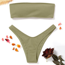 This is a pea green bandeau bikini set. The top has removable pads and elastic bands in the back to easily adapt the fitting for your body. The bottom has a low waist design and very comfortable. The set is made of nylon and spandex.