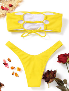 This is a yellow bandeau bikini set. The top has removable pads and elastic bands in the back to easily adapt the fitting for your body. The bottom has a low waist design and very comfortable. The set is made of nylon and spandex.