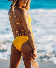 This beautiful and trendy yellow swimsuit is padded and has an open back, the yellow bands in the back give it a nice touch as they cross from side to side and helps the swimsuit highlight your bodylines. The material is solid and made of 82% nylon and 18% spandex.