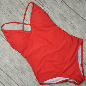 This red swimming suit is padded and has a deep cut in the back, the elastic bands in the back help to adapt the swimsuit to fit your body perfectly.  The material is nylon, polyester, acetate, and spandex.