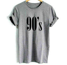 Trendy grey t-shirt with nineties printed on it. It has short sleeves, has an O-neck and it is made of cotton.