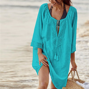 This is a traditional yet trendy turquoise cover-up tunica, it's perfect to put over your swimwear and it provides a high level of comfort and will make you look great.  Its arm length is three quarters long and the collar section is wide and shaped like a V, the width can be adjusted with a long lace with frilling at each end. The collar and is decorated with a beautiful floral embroidered pattern. This beautiful tunica is made out of cotton.
