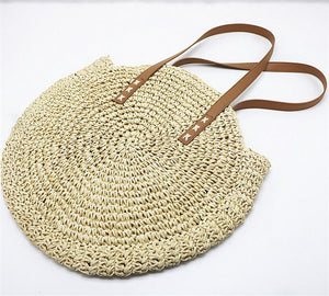 This modern beige shoulder bag's exterior has a retro paper circular design and is made out of hard straws and the lining material inside is polyester. It has multiple pockets, including a cell phone pocket. It has two shoulder straps that are 23cm / 9in to the top.