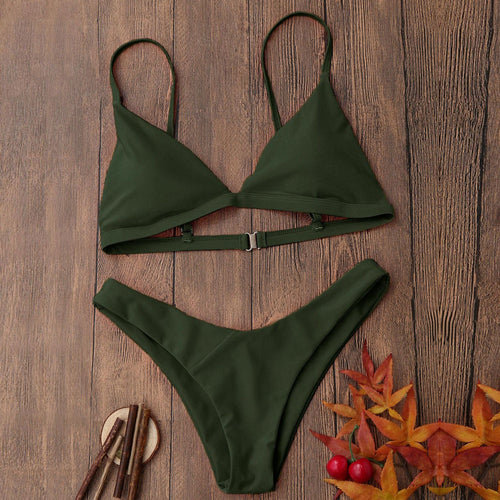 Our dark green Miami bikini looks really sophisticated; it has a triangular shape and is wire-free padded bikini top and a low waist bottom. The top has a clip and elastic bands in the back that makes this set fit your body perfectly.